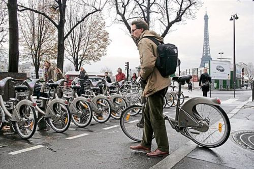 Everyone can: People in Paris can cycle commute using a public bike share service known as Velib.