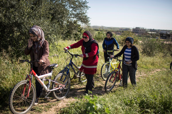 """Ms. Suleiman, center, and other women with their bikes in Gaza on Friday."" in http://www.postnewsreport.com/in-gaza-bicycles-are-a-battleground-for-women-who-dare-to-ride/"
